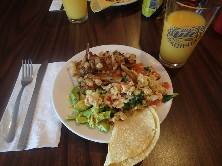 Breakfast at the Beer Stein, scramble, home fries, tortillas and avocado!